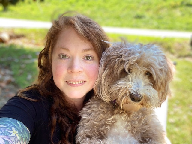 Jess Ayers, hospital manager and her dog